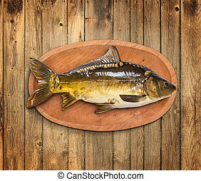 Common carp fish in wooden plate