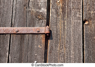 Old door hinge on wooden door