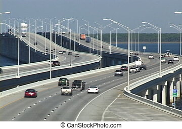 Traffic On Bridge - Traffic moves across Pensacola Bay on...