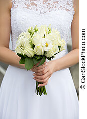 Wedding bouquet with green roses - Close up shot of bride...