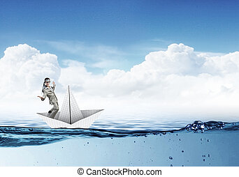 Businesman on paper boat - Businessman escapes from the...