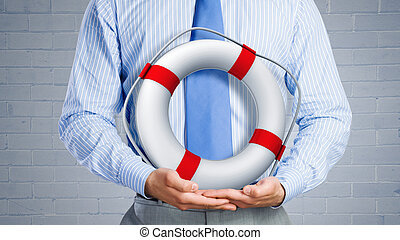 Life insurance - Close up of businessman with life buoy in...