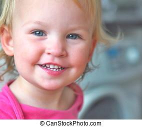 Happy little blond girl portrait.