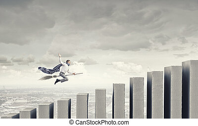 Guy on broom - Young businessman flying on broom and growth...