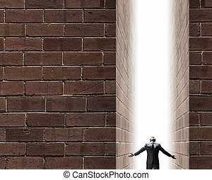 Man standing in light - Businessman with hands spread apart...