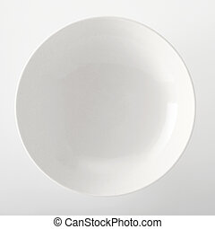 Empty plain white generic bowl viewed close up overhead with...