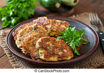 Zucchini pancakes with parsley. - Zucchini pancakes with...