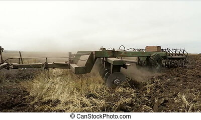Agricultural Tractor Plowing Rural Field - CLOSE UP: Rural...
