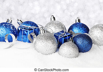 Christmas balls on snow - Blue and silver christmas balls...