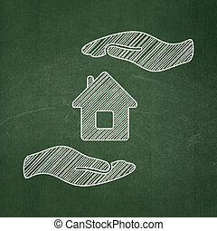 Insurance concept: House And Palm on chalkboard background -...
