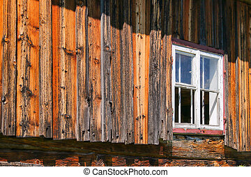 Weathered barn with white window frame, shallow depth of...
