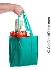Groceries in Hand - A strong hand holding an environmentally...