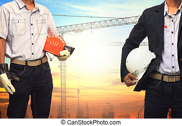 two engineer man working with white safety helmet against...