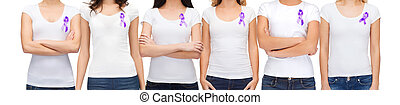 close up of women with purple awareness ribbon - charity,...
