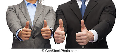 businessman and businesswoman showing thumbs up - business...
