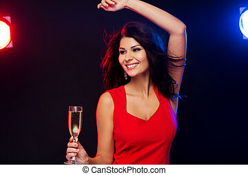 beautiful woman with champagne glass at nightclub - people,...