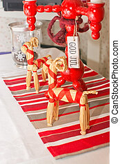 Dinner table rustic Christmas setting with straw goats and...