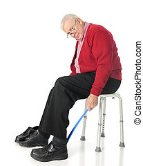 Independent Senior Using Assistive Dressing Device - Full...