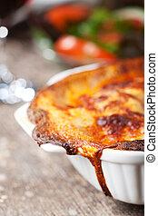 fresh lasagna dish in a baking dish