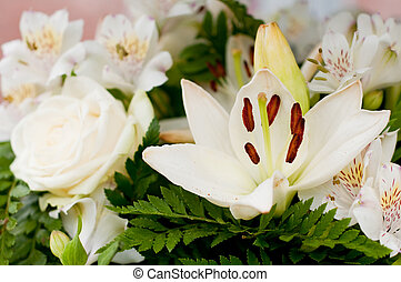 Flowers for the funeral - White flowers as roses and lily...