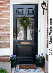 Dutch front door with flowers and lantern