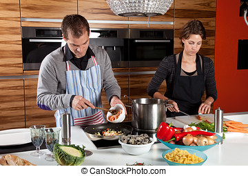 Cooking together - Man and woman together in the kitchen...