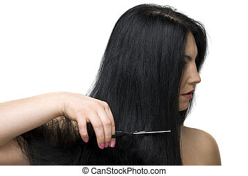 Cutting long hair - Beautiful brunette woman standing in...