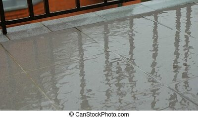 Wet ceramic tiles pavement in rainy day