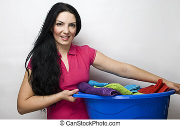 Housewife with basket of clean laundry - Smiling beauty...