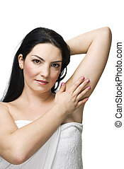 Health woman skin - Brunette woman touching her armpit and...