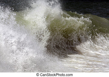Wave reaches shoreline - Close view of the impact of a wave...