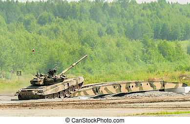 T-80 tank drives on bridge induced through obstacle -...