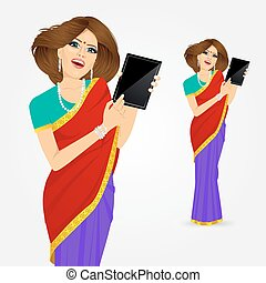 indian woman showing tablet screen