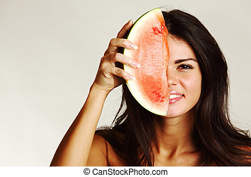 eat watermelon - woman hold watermelon in hands isolated on...