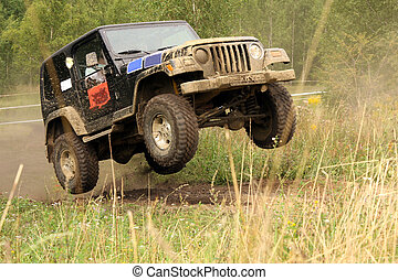 off-road - The vehicle jumping on the off –road raid route
