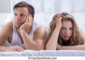 Couple having problems in bedroom - Young bored couple...