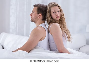 Couple sitting back to back - Couple with marital problems...