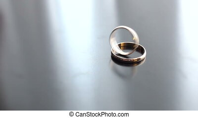 Wedding rings rotating in each other - beautiful wedding...