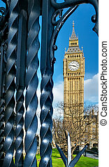 Big Ben and railings - Big Ben is framed by some wrought...