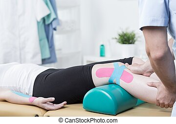 Patient with elastic therapeutic tape - Photo of patient...