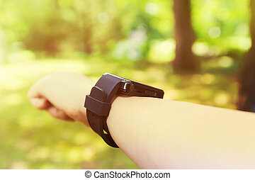 Man looking at his smart watch outside