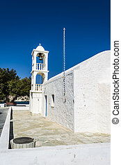White orthodox church at Mantrakia, Milos island, Greece -...