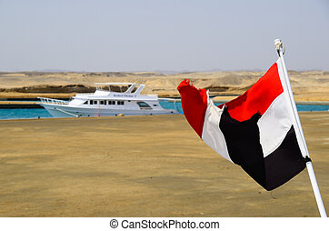 waving Egyptian flag in the port and holidays