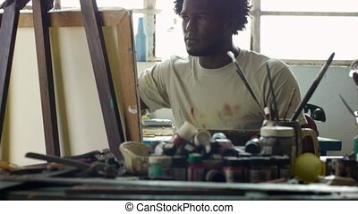 Professional Painter Working In Studio - Young black people...