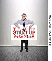 start up - happy businessman holding poster with drawing...