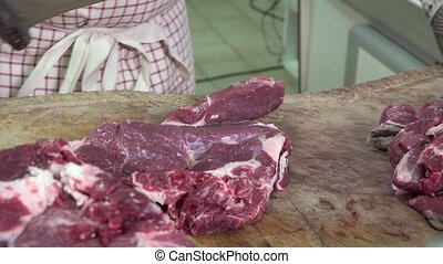 a butcher cutting meat cubes