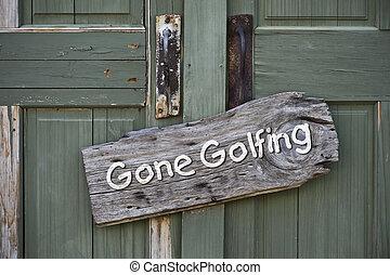 Gone Golfing. - Gone golfing sign on old green door.