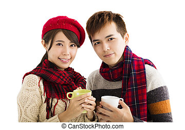 happy young couple drinking hot tea isolated on white background