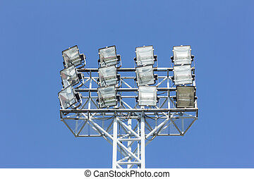 stadium spotlights with blue sky background
