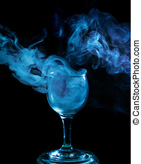 Blue smoke in the glass. Halloween. - Abstract art. Hookah...